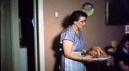Woman Brings Turkey Thanksgiving Christmas Meal 50s Vintage Film Home Movie 1716 Stock Footage