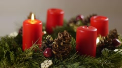Revolving advent wreath with igniting candles, slow speed Stock Footage