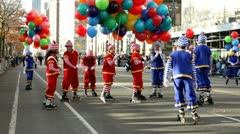 Roller skating clowns in Macy's parade Stock Footage