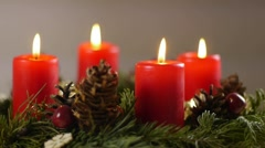 Revolving advent wreath with igniting candles, medium speed Stock Footage