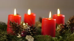 Revolving advent wreath with igniting candles, fast speed - stock footage