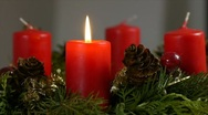 Stock Video Footage of One candle lights up on an advent wreath