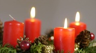 Stock Video Footage of Three candles lighted on an advent wreath
