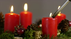 The last candle is lighted up on an advent wreath - stock footage