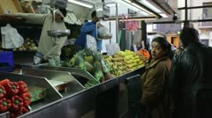 People at a fruit shop in a market Stock Footage