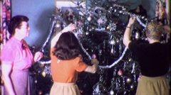 Family Decorates Trims Christmas Xmas Tree 1940s Vintage Film Home Movie 1731 - stock footage