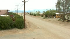 3 Motocycles On Street In Small Desert Town- Bombay Beach CA Stock Footage