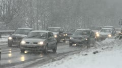 Snow storm on highway with slow moving traffic Stock Footage