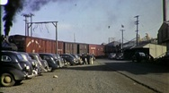 Stock Video Footage of Car Industrial Parking Lot Boxcars Circa 1955 (Vintage Film Home Movie) 1739