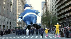 Balloons going down street Macy's parade Stock Footage