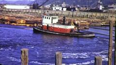 Tugboat Pushes Logs Logging Circa 1945 (Vintage Film Archival Footage) 1755 Stock Footage