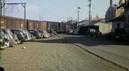 Stock Video Footage of Car Industrial Parking Lot Boxcars Circa 1955 (Vintage Film Home Movie) 1757