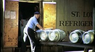 Stock Video Footage of Men Loading Refrigerator Boxcar Circa 1942 (Vintage Film Footage) 1757