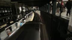 Subway Passing Below Blurred Pedestrians Stock Footage