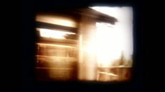 Train Window View Suburban Landscape Loop - Vintage Super8 Film Stock Footage