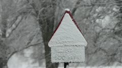 Blizzard and warning sign covered in snow Stock Footage