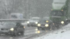 Blizzard on highway with slow moving vehicles (defocused) Stock Footage