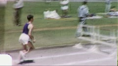 Athlete Jumps Hurtles Runner at Track Meet 1960s Vintage Film Home Movie 1785 - stock footage
