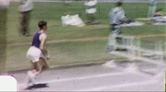 Athlete Jumps Hurtles Runner at Track Meet 1960s Vintage Film Home Movie 1785 Stock Footage