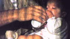 Grandpa Man Feeds Baby Grandchild Bottle 1950s Vintage Film Home Movie 1790 Stock Footage