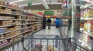 Grocery store cart bread isle HD Stock Footage