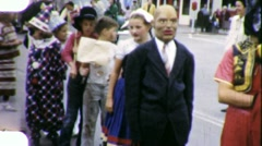 Children in Halloween Parade Circa 1957 (Vintage Home Movie Footage) 1801 Stock Footage