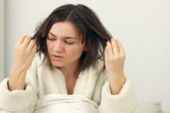 Young woman having a bad hair day Stock Footage