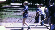 Stock Video Footage of Boys Play Shuffleboard Summer Camp Circa 1960 (Vintage Film Home Movie) 1819