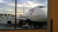 British Airways 747 at terminal Stock Footage