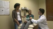 Stock Video Footage of Mom watches as son get a checkup (4 of 8)