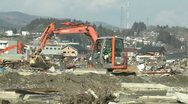 Stock Video Footage of Heavy Machinery In Tsunami Devastation Area In Kesennuma City Japan