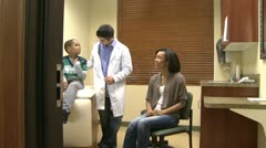 Doctor diagnoses a young boy (2 of 10) - stock footage