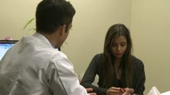 Doctor reassures distraught patient (4 of 6) - stock footage