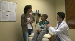Mom tells doctor about child's symptoms Stock Footage