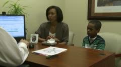 Doctor hands prescription to mom - stock footage