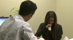 Doctor reassures distraught patient (2 of 6) - stock footage