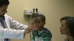 Doctor examines sick child - stock footage