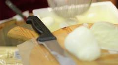 Knife divides fresh mozzarella - Italian food Stock Footage