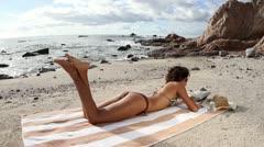 Beautiful bikini model sunbathing wild beach mexico Stock Footage