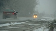 Stock Video Footage of cars go on a wet snowy road 005