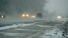 Cars go on a wet snowy road 011 Stock Footage