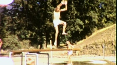 Boy Diving Jumps Off Diving Board Swimming Pool Vintage Film Home Movie 1831 Stock Footage