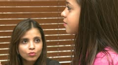 Young girl has throat checked while mom observes - stock footage