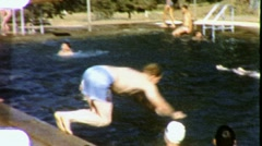 KIDS DIVE PLAY SWIM POOL Jump Splash 1960s Vintage Film Home Movie Footage 1832 - stock footage
