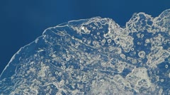 melting ice closeup on blue background. accelerated shoot - stock footage