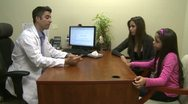 Stock Video Footage of Male doctor consults with mother and daughter (1 of 7)