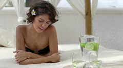 Bikini model day bed luxury hotel pool water healthy lifestyle Stock Footage