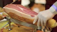 Expert caterer slicing ham Stock Footage