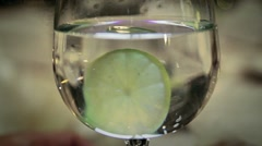 Lemon in Glass Stock Footage