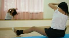 Woman exercising in dance studio Stock Footage